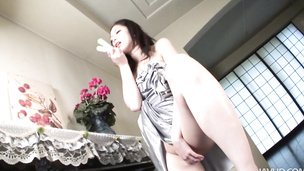 Extremely horny Hana goes for a bottle and a big dildo